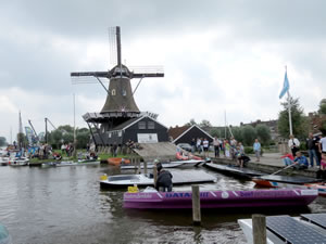 Old-style windmill overshadowing the solar boats
