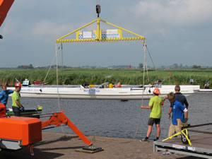 Boat being lifted from the water by a crane