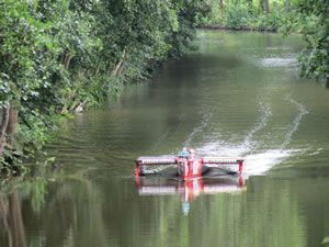 A solar boat in the narrow canal