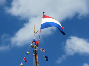 Netherlands flag flying on a ship's mast